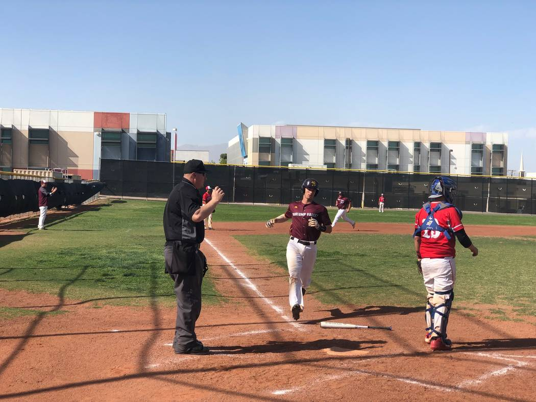 Tom Rysinski/Pahrump Valley Times Senior catcher Willie Lucas crosses the plate with one of sev ...