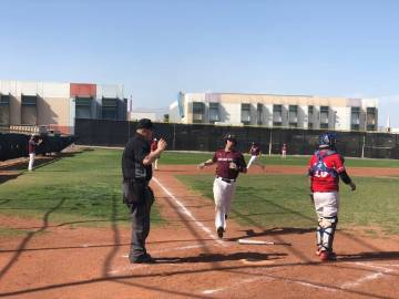 Tom Rysinski/Pahrump Valley Times Senior catcher Willie Lucas crosses the plate with one of sev ...