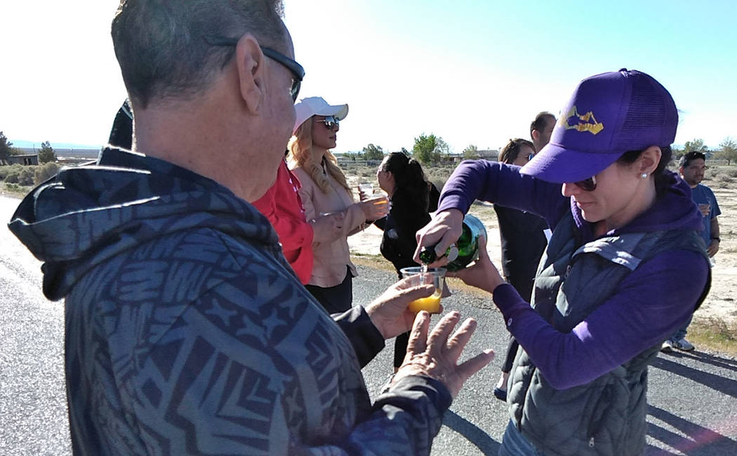 Selwyn Harris/Pahrump Valley Times A Vegas Balloon Rides staff members provides passengers with ...