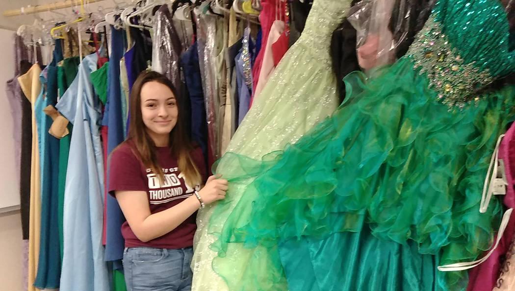 Selwyn Harris/Pahrump Valley Times PVHS Senior Sabrina Jaynes displays one of the many prom dre ...