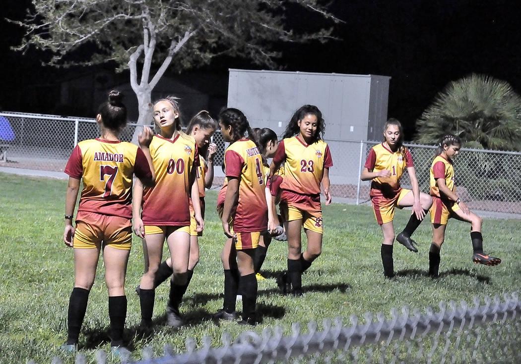 Horace Langford Jr./Pahrump Valley Times Pahrump Junior Trojans Soccer Club players warm up Mon ...