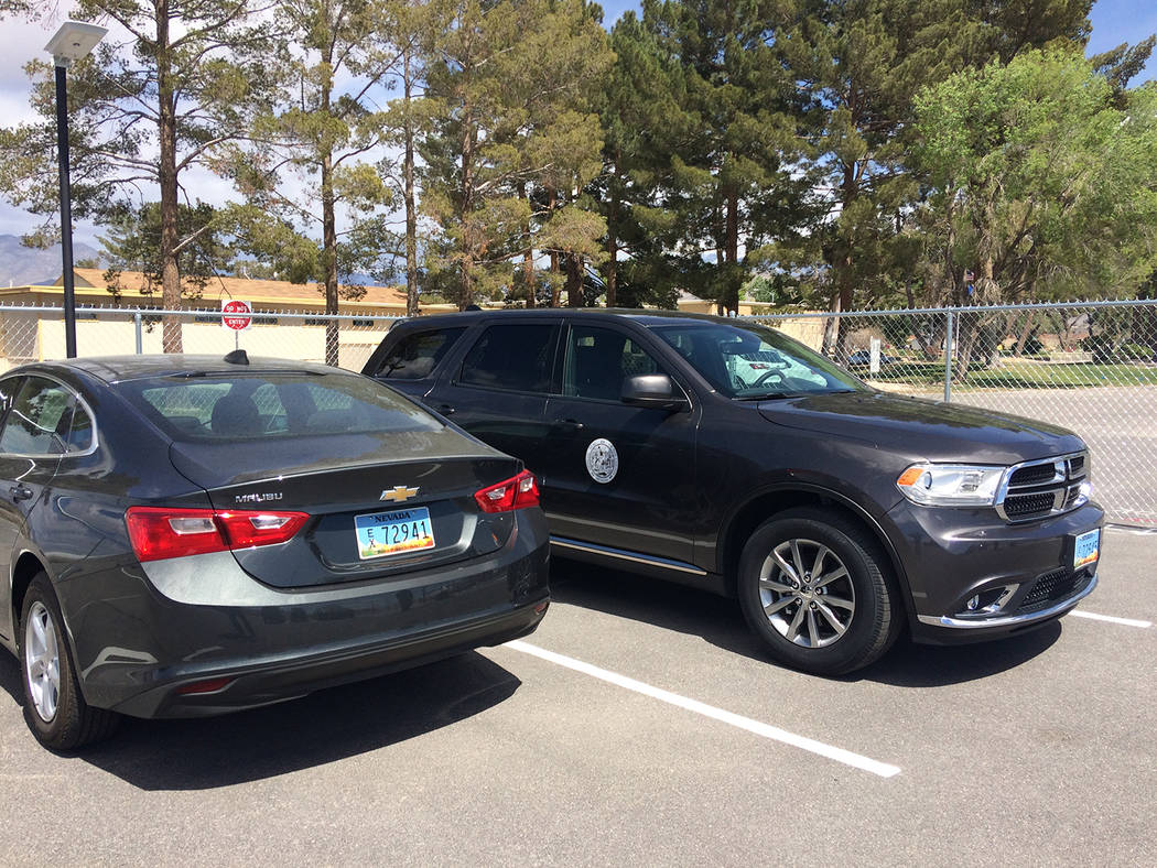 Robin Hebrock/Pahrump Valley Times Pictured are two of the 35 vehicles obtained by Nye County i ...