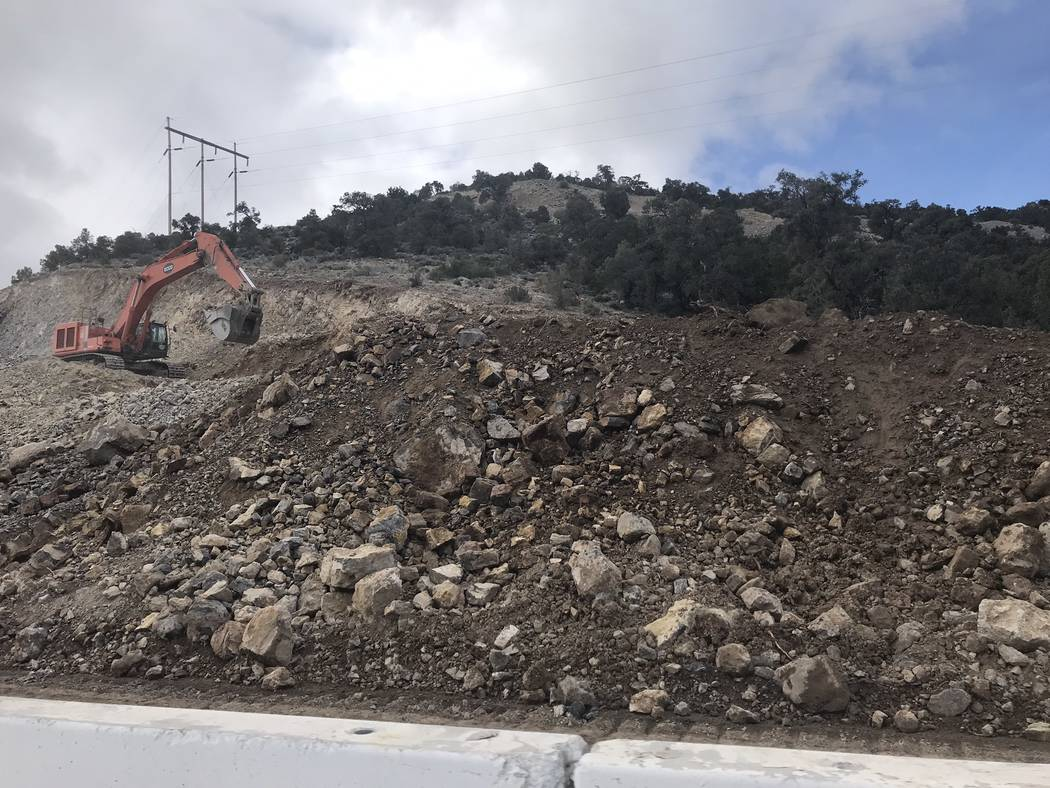 Jeffrey Meehan/Pahrump Valley Times Heavy equipment moves along in the mountain pass along High ...