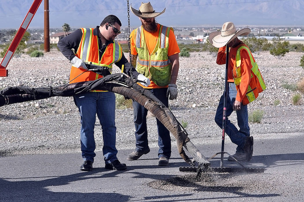 Horace Langford Jr./Pahrump Valley Times Nye County Commissioner Leo Blundo is pictured filling ...