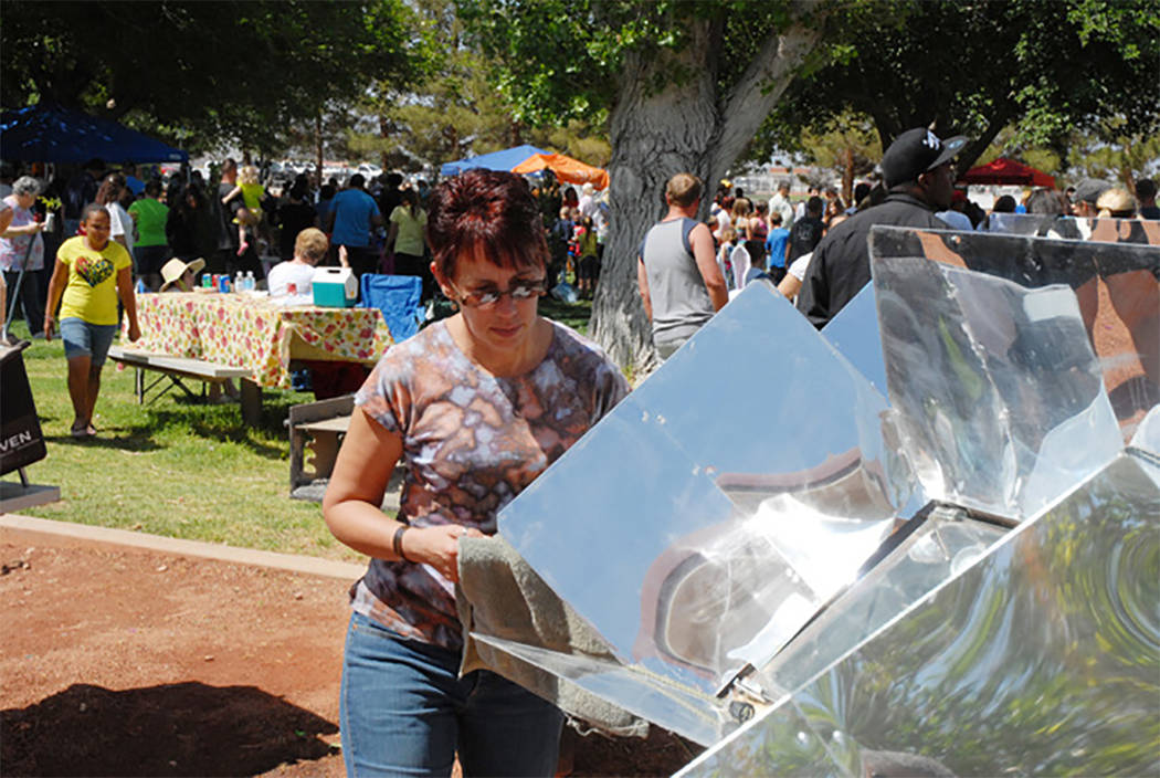 Patti Scharf is shown giving a baking demonstration with solar ovens during a previous Earth Da ...