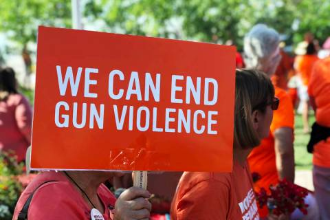 A sign promoting an end to gun violence is held up at the Wear Orange campaign event at the Las ...