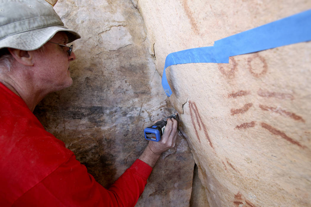 Wyatt Mulvey, a volunteer with Friends of Red Rock Canyon, works Thursday, May 19, 2011, to res ...