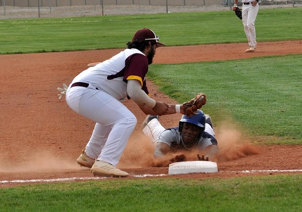 Horace Langford Jr./Pahrump Valley Times Senior Nico Velazquez takes a throw at third base duri ...