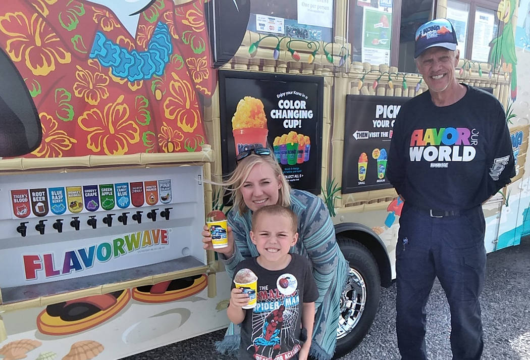 Selwyn Harris/Pahrump Valley Times Nicole Smith joins her son Drew with a shaved ice cup. Drew' ...