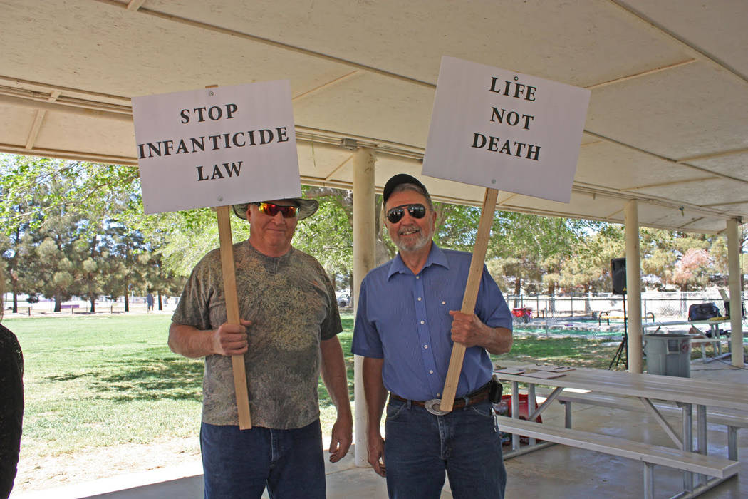 Robin Hebrock/Pahrump Valley Times Signs proclaiming a stance against abortion were hoisted by ...