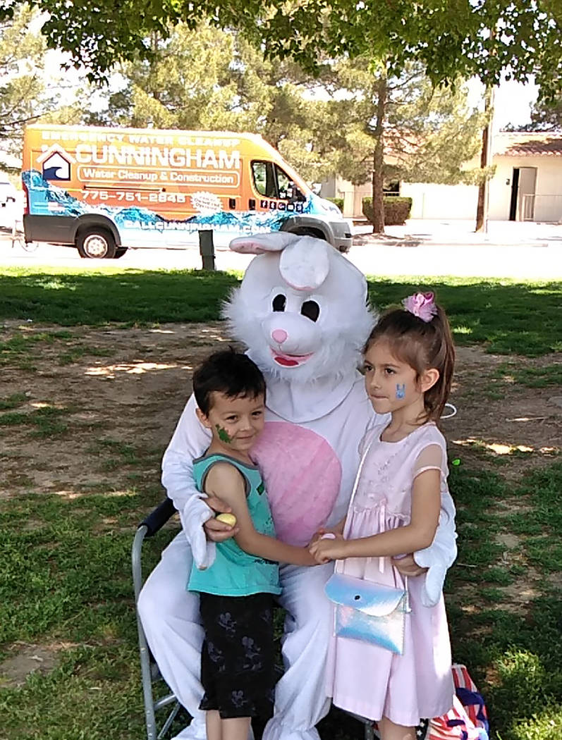 Selwyn Harris/Pahrump Valley Times Two youngsters spend some quality time with the Easter Bunny ...