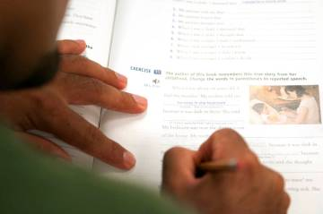A College of Southern Nevada student completes various book exercises during his intermediate E ...