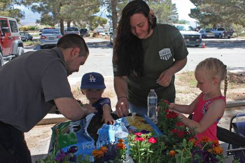 Robin Hebrock/Pahrump Valley Times Volunteers from the Home Depot spend time teaching youngster ...