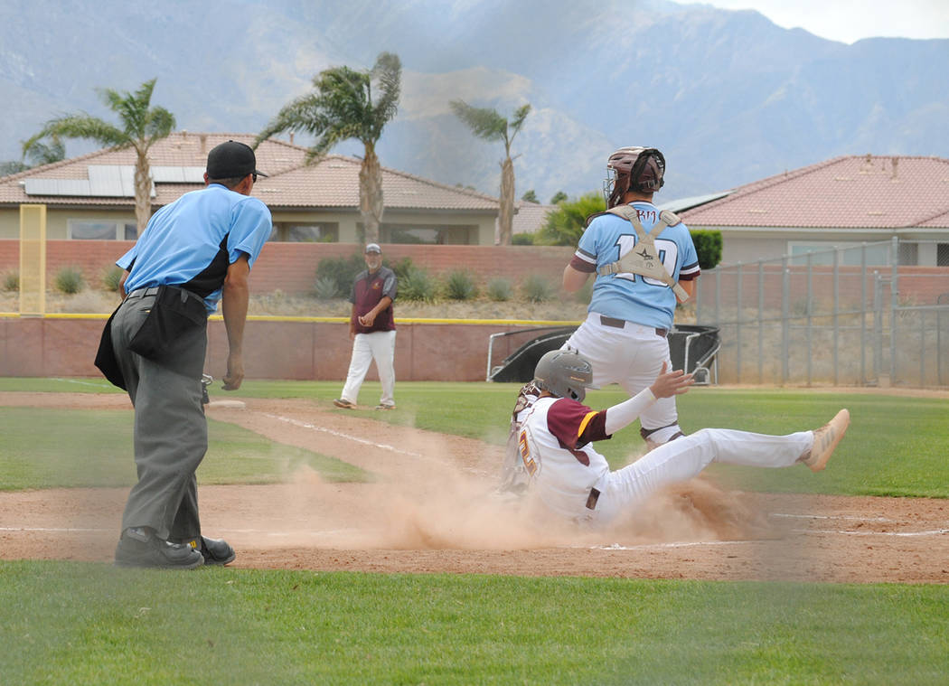 Charlotte Uyeno/Pahrump Valley Times Pahrump Valley senior Joey Koenig slides safely into home ...