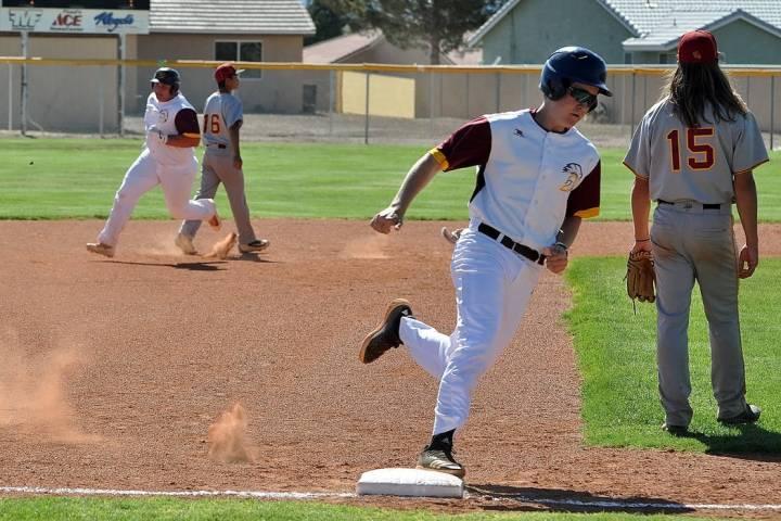 Horace Langford Jr./Pahrump Valley Times Pahrump Valley senior Zach Trieb chases junior teammat ...