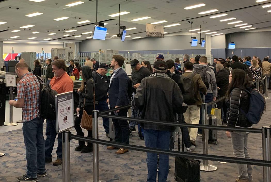 Passengers wait in the TSA screening line at McCarran International Airport, Jan. 11, 2019. (Mi ...
