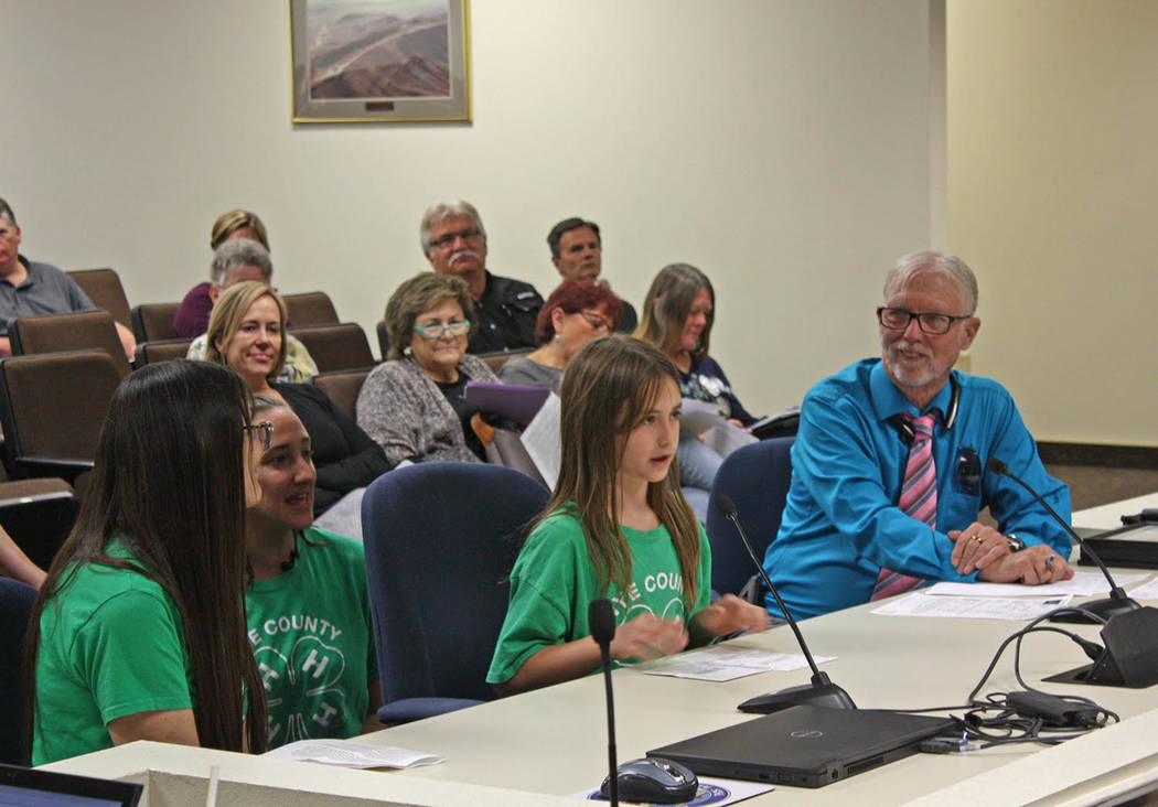 Robin Hebrock/Pahrump Valley Times 4H member Elaina Domina, second from right, speaks before th ...