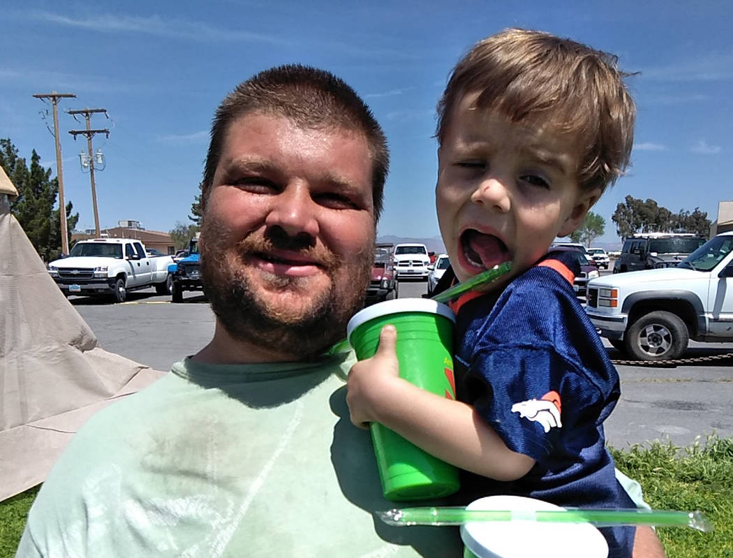 Selwyn Harris/Pahrump Valley Times Justice Evans and son Jake spent much of the day walking the ...