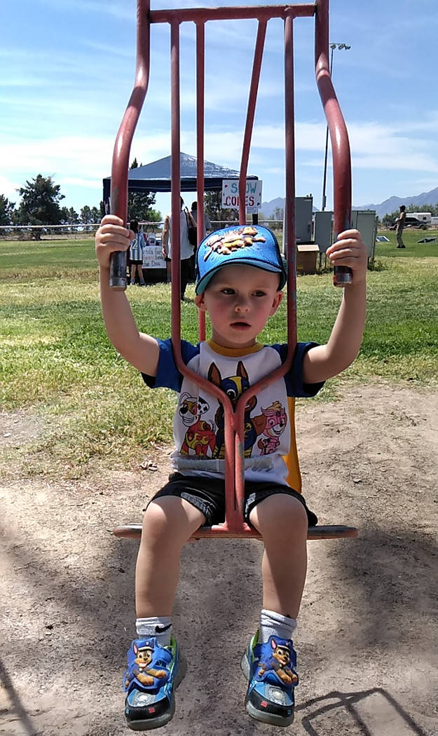 Selwyn Harris/Pahrump Valley Times A young attendee opted for some playground time during the A ...