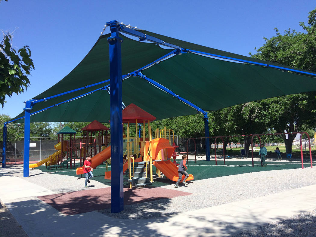 Robin Hebrock/Pahrump Valley Times New shade structures grace the playground at Petrack Park. T ...
