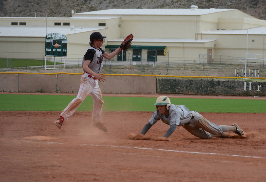 Jo Eason/Special to the Pahrump Valley Times Beatty senior Jacob Henry slides into third base a ...