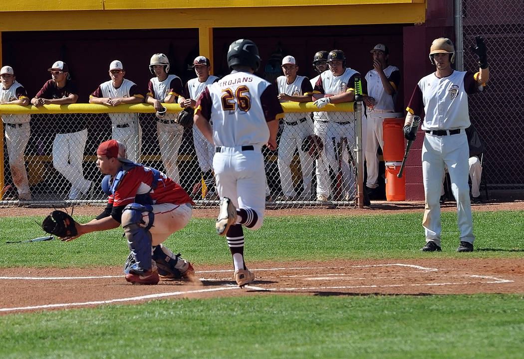 Horace Langford Jr./Pahrump Valley Times Pahrump Valley senior Tyler Floyd scores a run during ...
