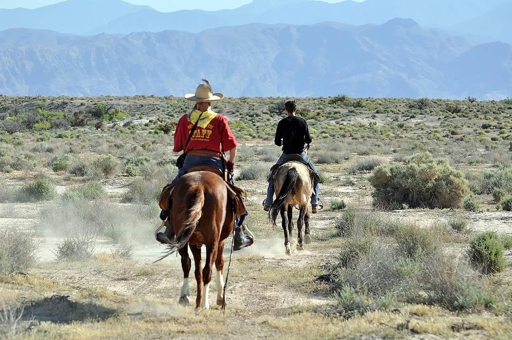 Horace Langford Jr./Pahrump Valley Times - With a vast desert landscape before them, equestria ...
