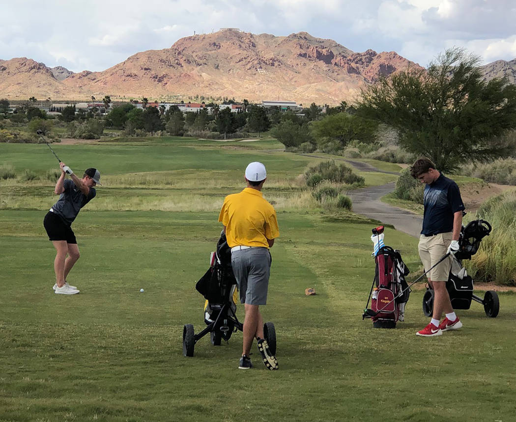 Tom Rysinski/Pahrump Valley Times Pahrump Valley's Ian Kingsley, left, tees off on No. 15 at th ...