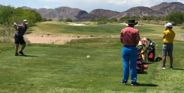 Tom Rysinski/Pahrump Valley Times Pahrump Valley's Koby Lindberg tees off Tuesday on the first ...
