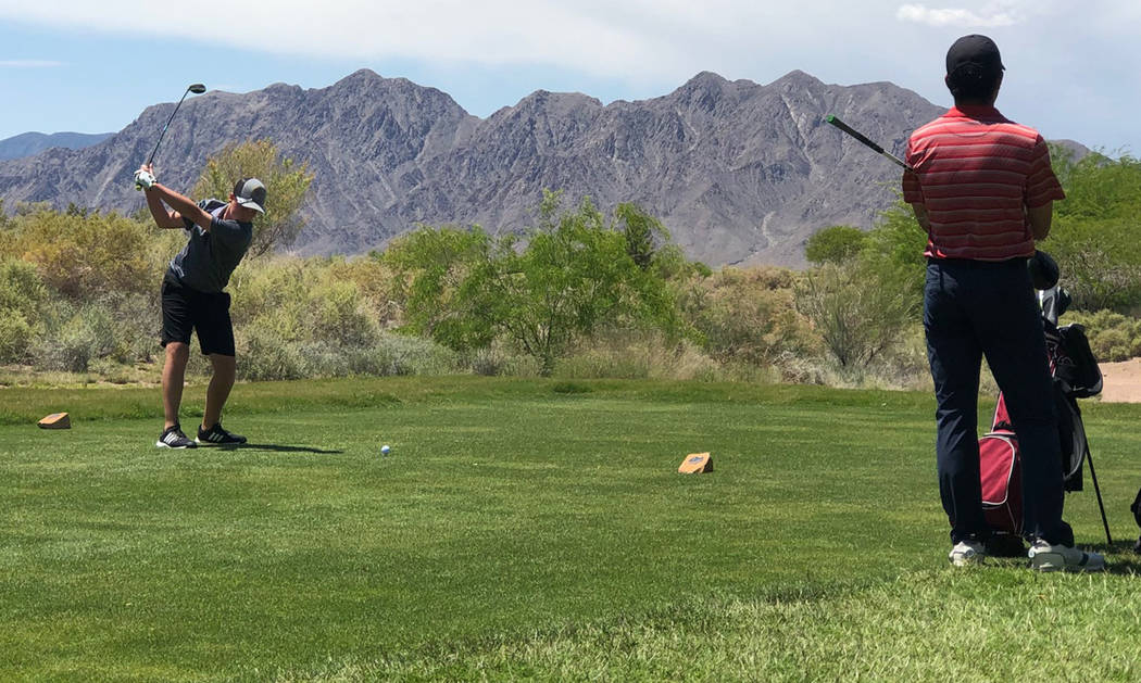 Tom Rysinski/Pahrump Valley Times Kasen Moore of Pahrump Valley opens his second round at the C ...