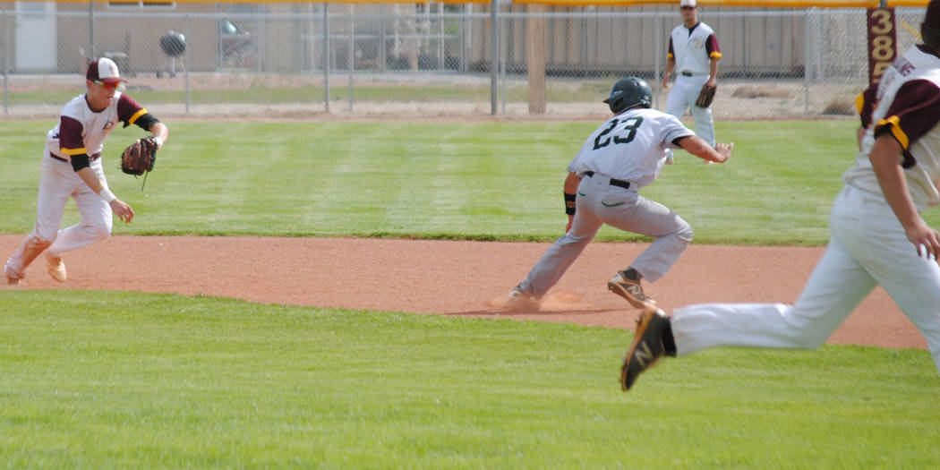 Charlotte Uyeno/Pahrump Valley Times Pahrump Valley's Chase McDaniel, left, chases Virgin Valle ...