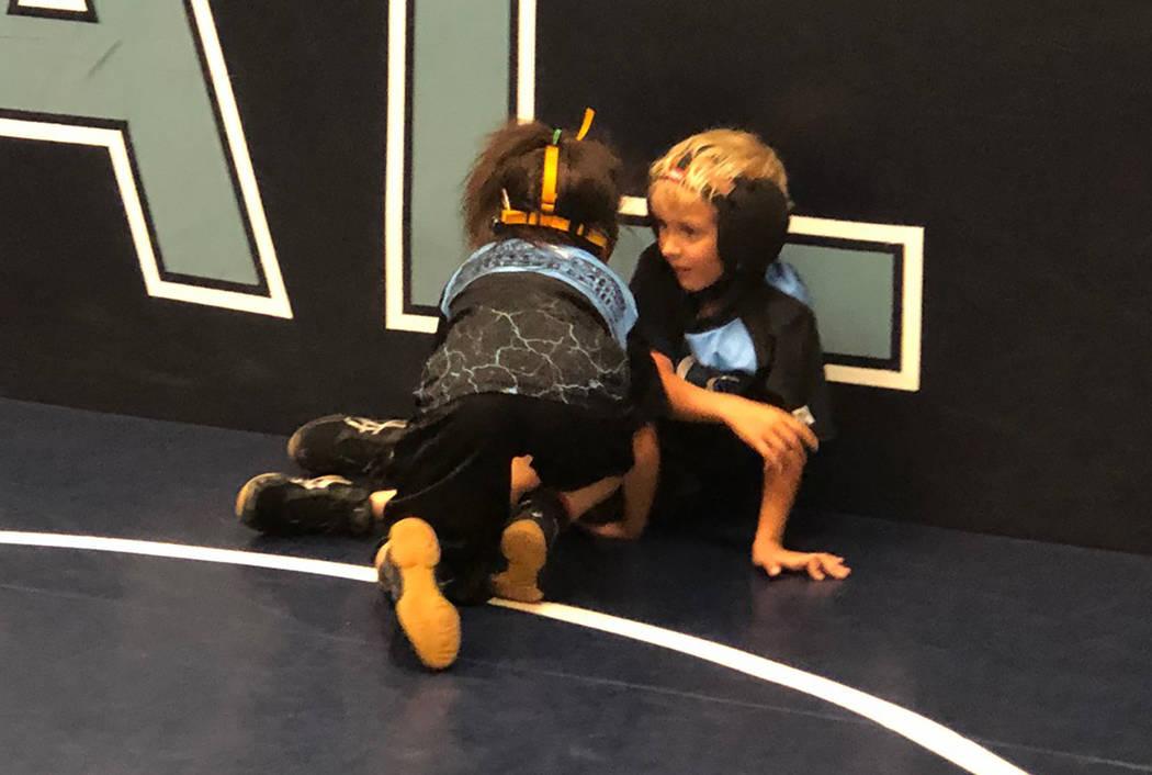 Tom Rysinski/Pahrump Valley Times Suri Yoffee, 7, of Pahrump wrestles during practice at Centen ...