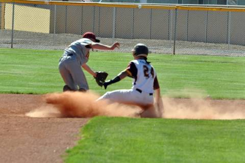 Horace Langford Jr./Pahrump Valley Times Senior Willie Lucas reaches second base in a cloud of ...
