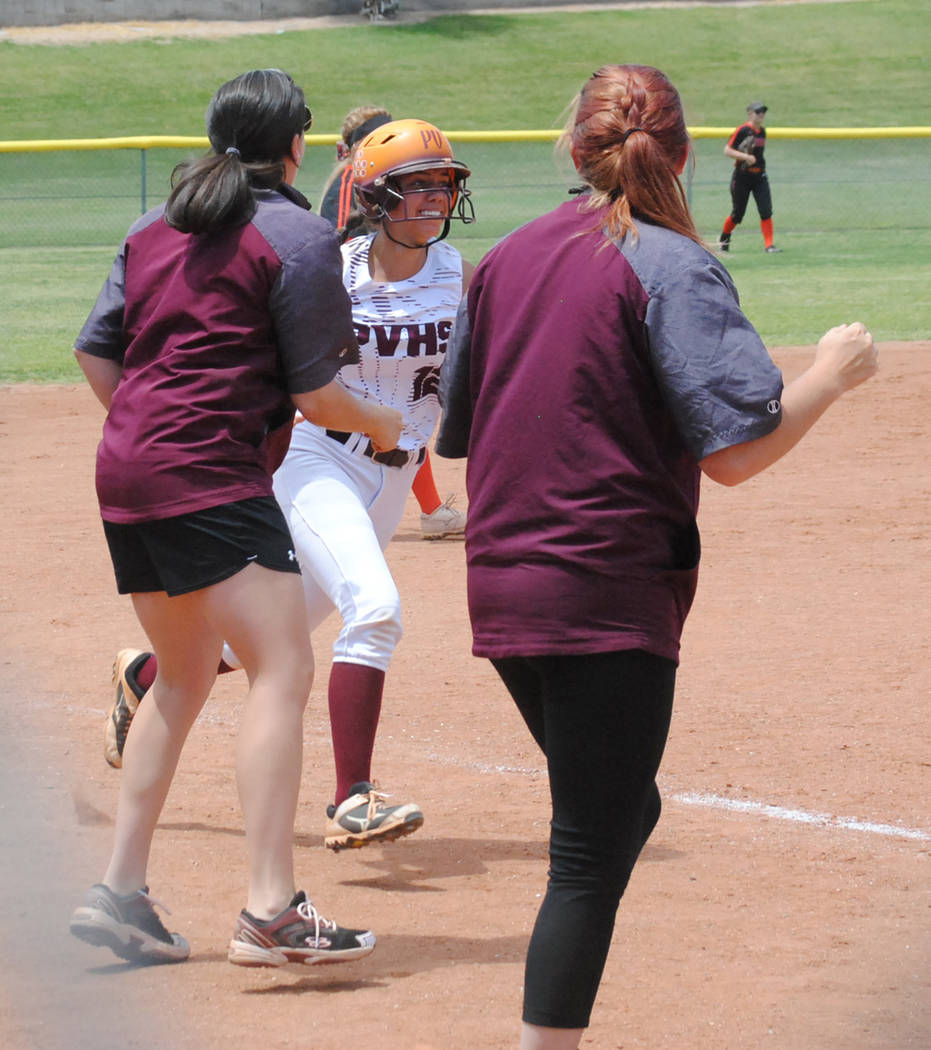 Charlotte Uyeno/Pahrump Valley Times Pahrump Valley's Kaden Cable rounds third and heads for ho ...