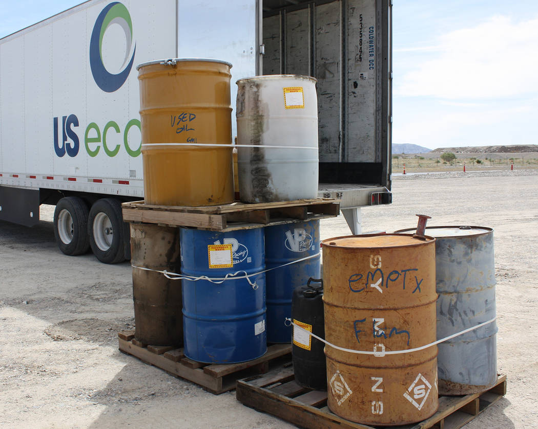 Robin Hebrock/Pahrump Valley Times Used oils and other liquid materials were placed in large ba ...