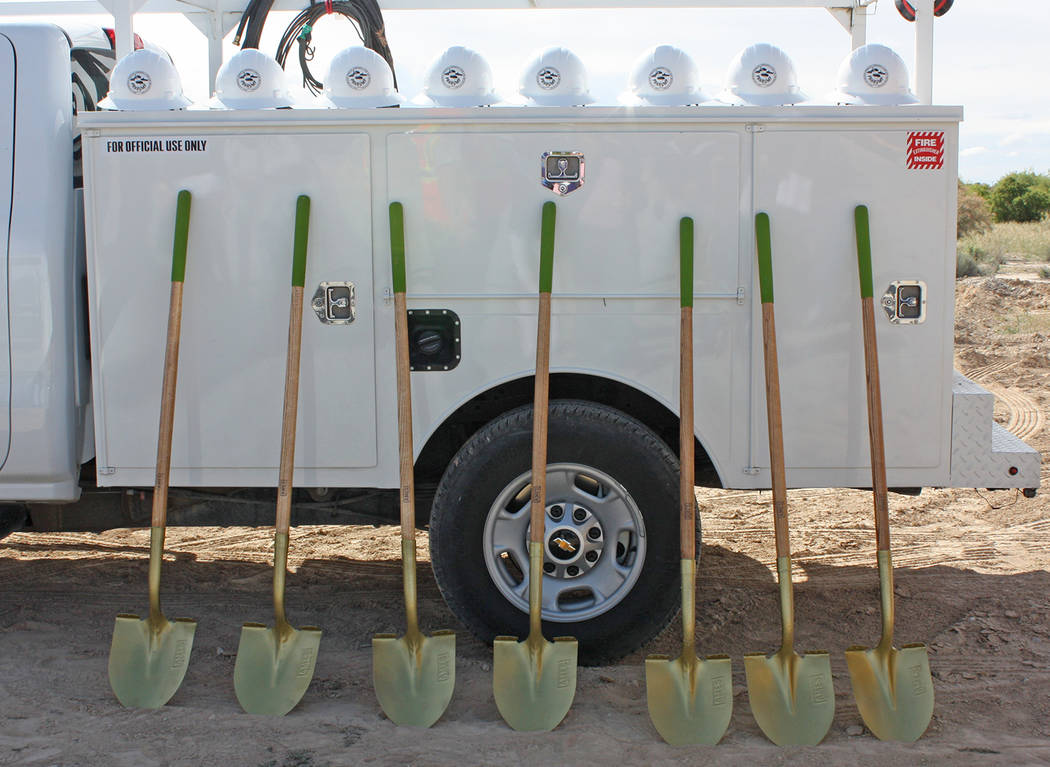 Robin Hebrock/Pahrump Valley Times Golden shovels and gleaming white hardhats stand in readines ...