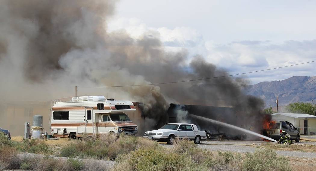 Charles Hoover/Special to the Pahrump Valley Times Upon arrival, fire crews began what's know ...