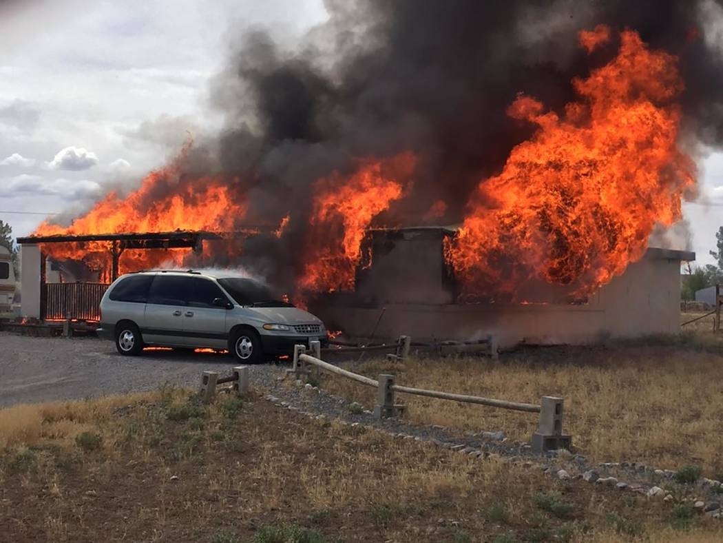 Special to the Pahrump Valley Times A late morning fire destroyed a double-wide manufactured ho ...