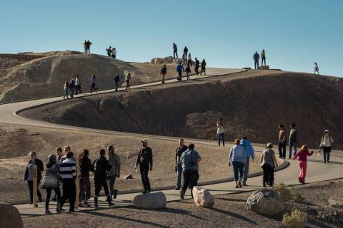 Death Valley National Park photo This photo shows visitors to Zabriskie Point in Death Valley N ...