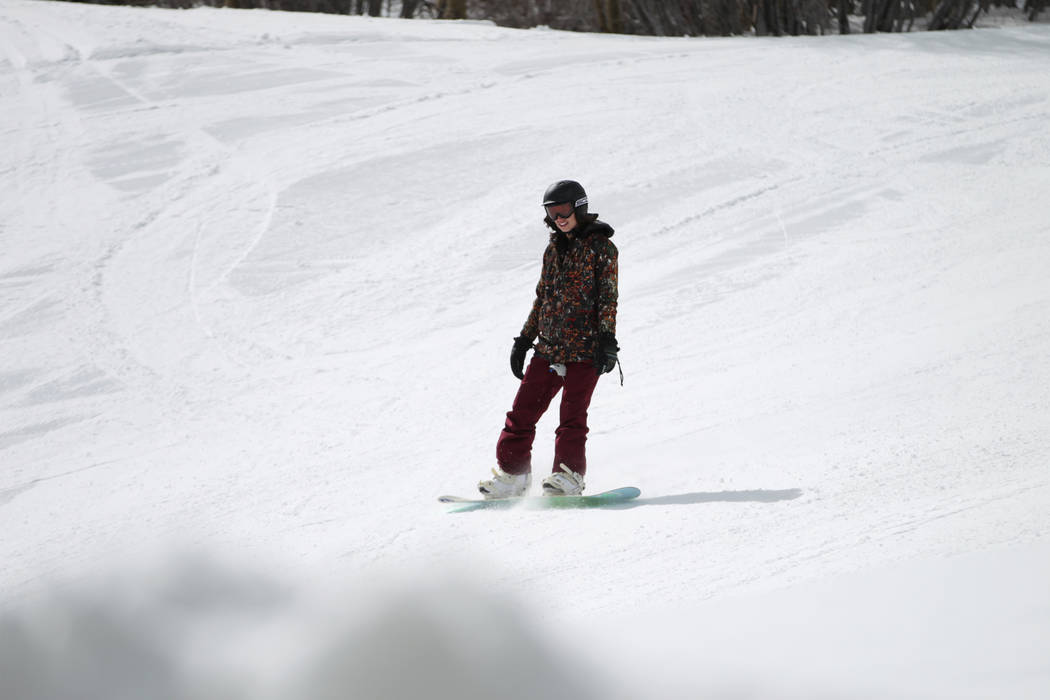 A person snowboards down a hill at Lee Canyon in Las Vegas, Friday, March 8, 2019. Erik Verduzc ...