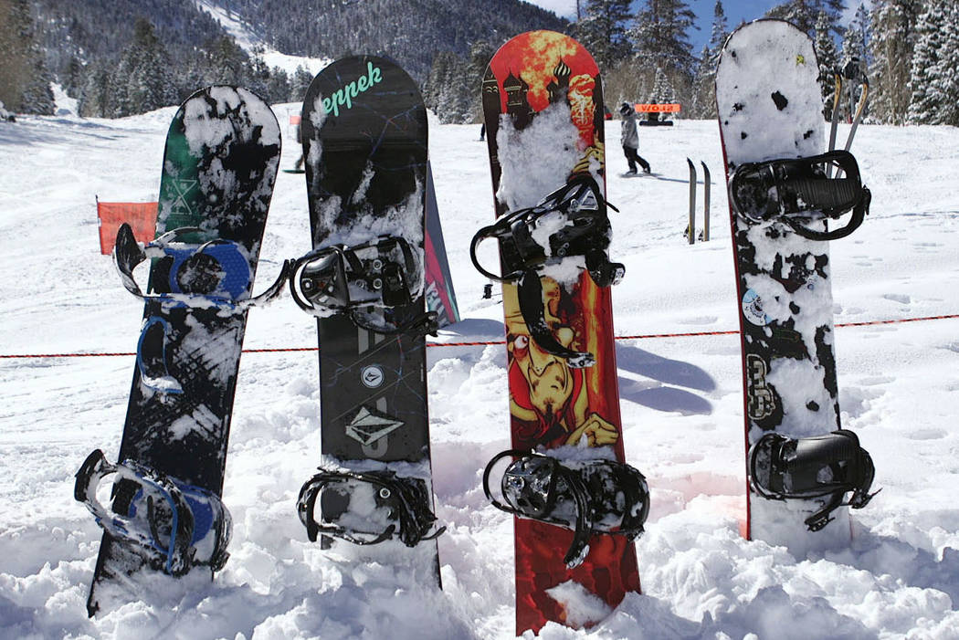 Snowboards stick up from the fresh snow at Lee Canyon outside Las Vegas on Monday, Feb. 18, 201 ...