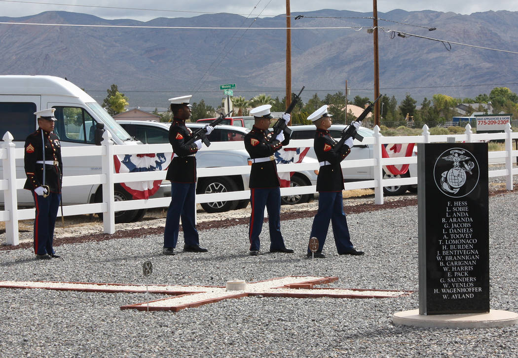 Robin Hebrock/Pahrump Valley Times A rifle salute executed by Marines from the Inspector-Instru ...