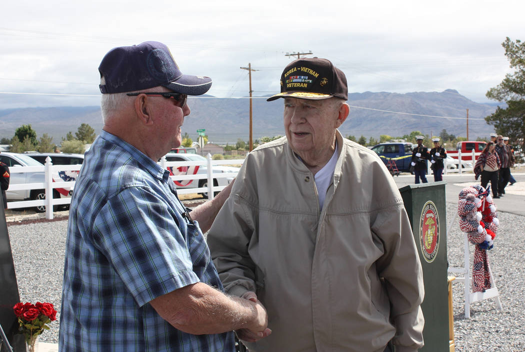 Robin Hebrock/Pahrump Valley Times Marine Corps Maj. Roger Chaput shakes hands with ceremony at ...