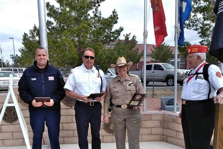 Selwyn Harris/Pahrump Valley Times Pahrump Valley Fire and Rescue Services Scott Lewis, center ...