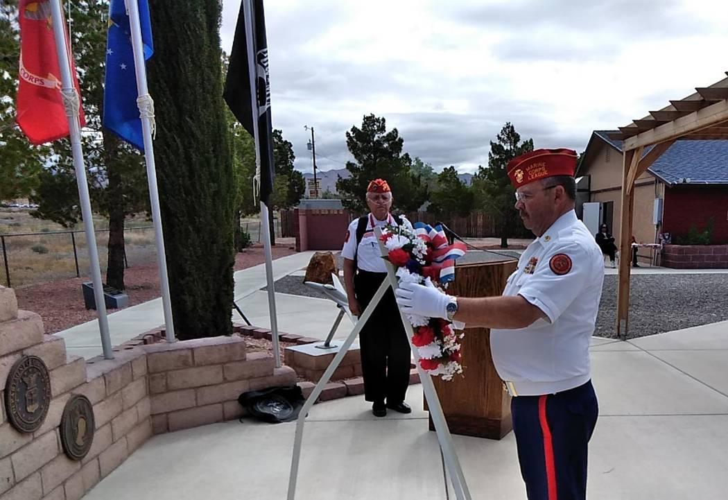 Selwyn Harris/Pahrump Valley Times Pahrump Marine Corps League's Burt Gioux hangs a patriotic w ...
