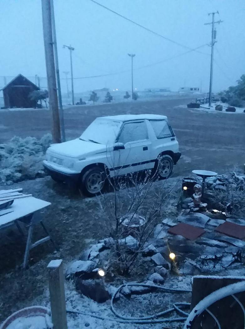 Teresa Doreen/Special to the Times-Bonanza Snow dusts an SUV in the Goldfield area on May 26 as ...