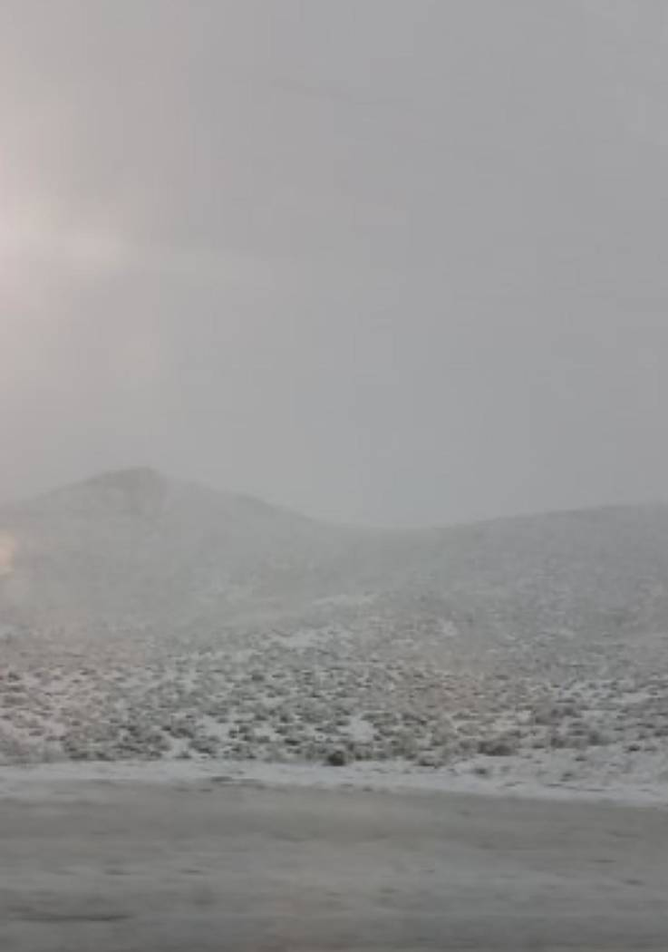 Vikki Beko/Special to the Times-Bonanza Snow covers a mountainside, desert and roadway coming i ...