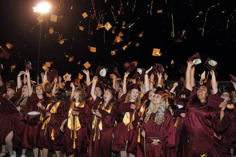 Horace Langford Jr./Pahrump Valley Times The Class of 2019 at Pahrump Valley High School toss ...