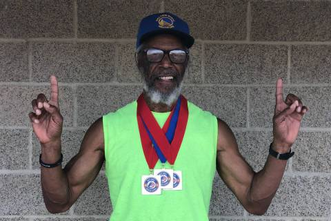 Tom Rysinski/Pahrump Valley Times Pahrump resident Marvin Caperton with the three medals he won ...