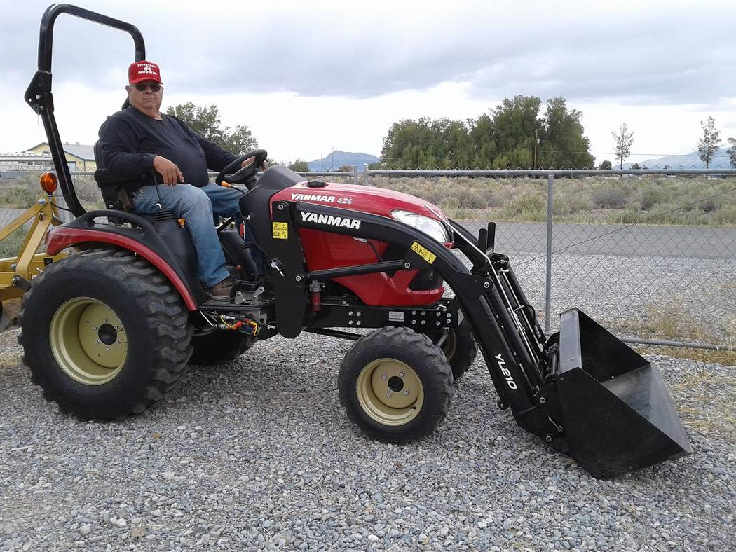 Special to the Pahrump Valley Times Clarence Wenham sits aboard his brand new Yanmar tractor, w ...